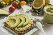 Fresh Avocado Spread Guacamole As Healthy Breakfast On White Background poster