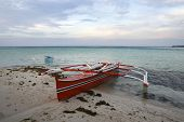 stock photo of camiguin  - traditional banca outrigger boats in the philippines - JPG