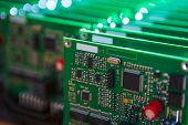 Modern Electronics Ideas. Closeup Of Lot Of Electronic Printed Circuit Boards With Lots Of Surface M poster