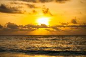 Dramatic Sunset Sky With Clouds Over Ocean. poster