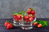 Lemonade Drink Of Soda Water, Strawberry And Mint Leaves In Glass On Wooden Table, Copy Space. Refre poster