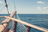 View of the horizon from the old wooden ship. The bow of a vintage ship. The wooden stem of the ship poster