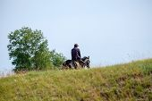 A Rider On A Horse Hiding Behind A Hill. Summer Day, A Shepherd On Horseback poster