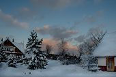 Russia. South Of Western Siberia. Picturesque Cold Sunset In The Snow-covered Village Of Mountain Sh poster