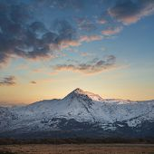 Majestic Landscape Image Of Snowdonia Snowcapped Mountains With Dramatic Sunset Clouds And Beautiful poster