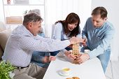 Elderly Couple And Elderly Couple Collect Wooden Blocks At Home poster