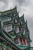Ancient Hongen Pagoda Tower With Green Tiled Red Columns In Chongqing, Southwest Metropolis In China poster