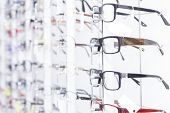 Glasses, Optical Glass Store, A Number Of Glasses At Opticians. Store Points. Stand With Glasses In  poster