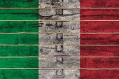 National Flag  Of Italy On A Wooden Wall Background. The Concept Of National Pride And A Symbol Of T poster