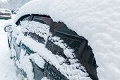 Parked Car Covered By Thick Snow Layer After Winter Blizzard - Close-up With Selective Focus poster