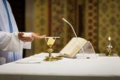foto of eucharist  - Priest during a wedding ceremony - JPG