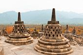 Ancient Stupas In Borobudur Buddhist Temple. Mahayana Buddhist Temple In Java poster