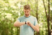Counting Calories. Wrist Band Gadget. Athlete Check Fitness Tracker Nature Background. Athlete With  poster