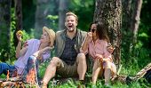 Company Friends Relaxing And Having Snack Picnic Nature Background. Halt For Snack During Hiking. Co poster