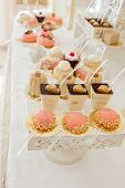 Desserts With Fruits, Mousse, Biscuits. Different Types Of Sweet Pastries, Small Colorful Sweet Cake poster