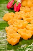 foto of yoke  - thai dessert thai sweets on the leafmade of bean-paste egg yoke