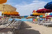 View Of Varazze Beach And Its Typical Colored Sun Umbrellas, The Parasols Are Arranged In Rows poster