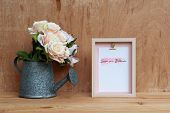 Mockup Still Life Picture Frame And At Watering Can With Bouquet Of Roses On Rusty Wood. Valentines  poster