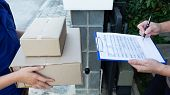 Young Delivery Man Deliver Box Parcel Package And Sending To Customer In Front Of The House, Man Cus poster