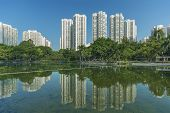 Residential Building And Pond In Residential District In Hong Kong City poster