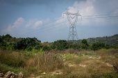 High Voltage Electric Poles For Power Transmission Passing Through Reserve Forest. Power Distributio poster