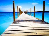 A Photo Of Nature Taken On A Smartphone. Pier Going Into The Blue Sea. Beautiful Boat Dock In Bali.  poster