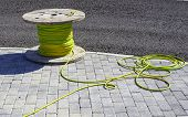 Wire Electric Cable With Wooden Coil Of Electric Cable Waiting To Be Slipped Into The Conduit poster