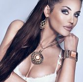 Portrait Of Beautiful Brunette Woman Wearing Gorgeous Jewellery.