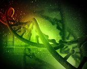 pic of genes  - DNA molecule is located in front of a colored background - JPG