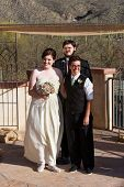 image of rabbi  - Happy lesbian couple at civil union with rabbi - JPG