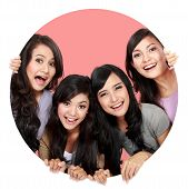 pic of peep hole  - Group of beautiful women smiling peeping through circle hole - JPG