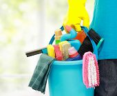 stock photo of broom  - close up portrait of mans hand with cleaning equipment - JPG