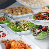 stock photo of buffet catering  - Variety of cold vegetable platters on a buffet table at a catered event or wedding reception - JPG