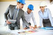 stock photo of real-estate-team  - Team of architects presenting construction project - JPG