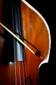 stock photo of double-bass  - Color detail of a vintage double bass - JPG