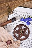 pic of pentacle  - wooden pentacle with incense burning with hand written book of shadows and flowers  - JPG