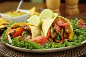 stock photo of chicken  - chicken fajita  with guacamole and tortillas  - JPG