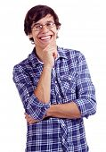 Laughing latin young man with hand on his chin isolated on white background