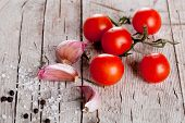 stock photo of peppercorns  - cherry tomatoes - JPG