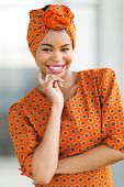 foto of traditional attire  - attractive african american woman wearing traditional attire - JPG