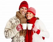 picture of hot couple  - Christmas couple drinking hot tea isolated over white background - JPG