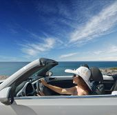 picture of beetle car  - Women traveling in a convertible on Resorts - JPG