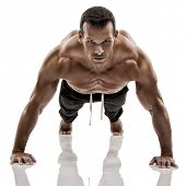 stock photo of abdominal muscle  - Muscle man dmaking push ups in studio - JPG