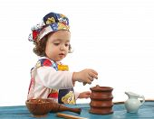 Little Girl Cooking Dressed As A Cheff poster