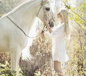 stock photo of horse girl  - Portrait of a beauty blondie with horse - JPG