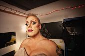 foto of drag-queen  - Serious drag queen with bra and tattoo in dressing room - JPG