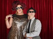stock photo of drag-queen  - Tall drag queen and retro style man in sunglasses - JPG