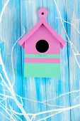 stock photo of nesting box  - Decorative nesting box  with color branches - JPG