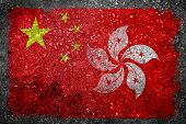stock photo of merge  - Merged Flag of China and Hong Kong painted on grunge concrete - JPG