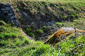 foto of trough  - Scene with rocks and nature in spring with dried up trough. ** Note: Shallow depth of field - JPG